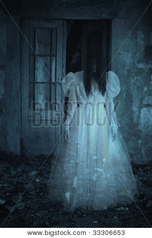 Horror scene of scary woman in the wedding dress