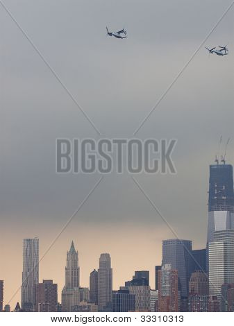 HOBOKEN, NJ - MAY 23: Two military Osprey aircraft fly above a Manhattan along the Hudson River during the Parade of Sails on May 23, 2012 in Hoboken, NJ. The parade marks the beginning of Fleet Week.