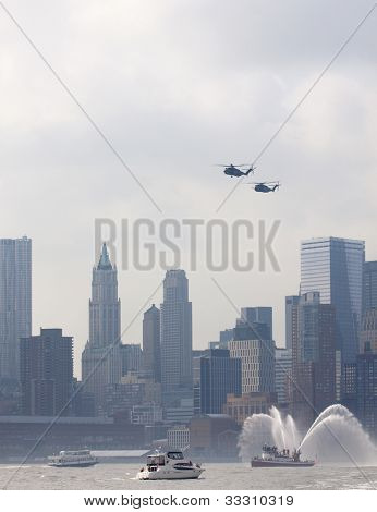 HOBOKEN, NJ - MAY 23: Military helicopters fly up the Hudson River with Manhattan in the background during the Parade of Sails on May 23, 2012 in Hoboken, NJ. The parade marks the start of Fleet Week.