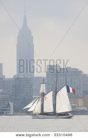 HOBOKEN, NJ  MAY 23: Tall ship Etoile (France) sails on the Hudson River with Manhattan as a backdrop during the Parade of Sail on May 23, 2012 in Hoboken, NJ. The parade is the start of Fleet Week.