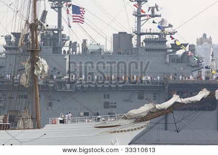 HOBOKEN, NJ  MAY 23: The warship USS Wasp (LHD 1) sails past a tall ship on the Hudson River during the Parade of Sail on May 23, 2012 in Hoboken, NJ. The parade is the start of Fleet Week.