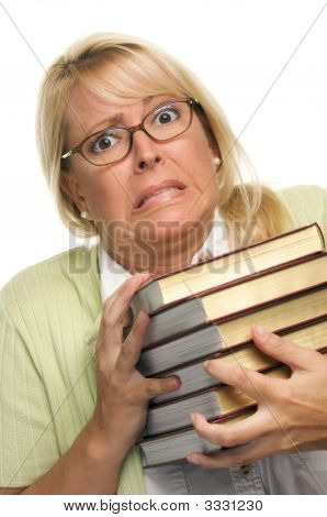 Stressed Woman With Pile Of Books