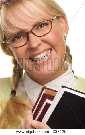 Cute Student With Retainer Carrying Her Books