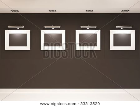 Showroom. Four Empty Frames On The Black Wall In Modern Interior. Photos In Gallary