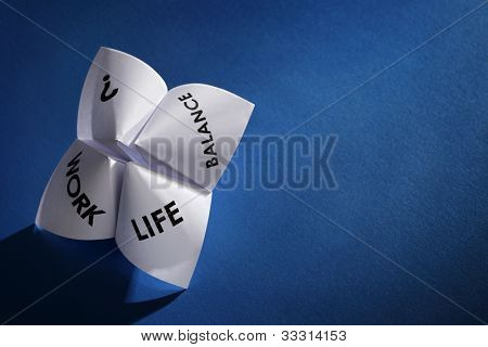 Origami fortune teller concept for work life balance choices