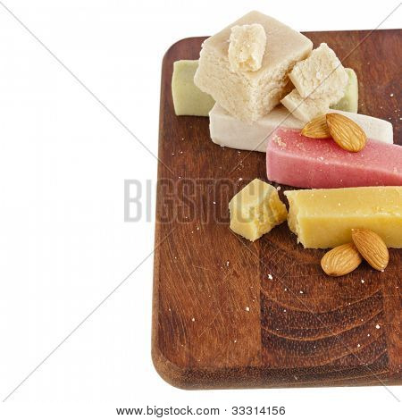 marzipan  with almonds on wooden board