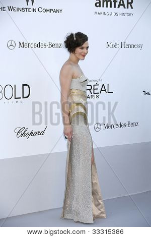 ANTIBES - MAY 24: Milla Jovovich at the 2012 amfAR's Cinema Against AIDS at Hotel Du Cap on May 24, 2012 in Antibes, France