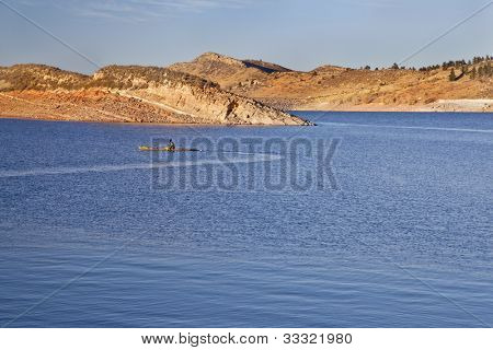 sea kayak on Horsetooth Reservoir near Fort Collins, Colorado, late summer or fall scenery in sunset light