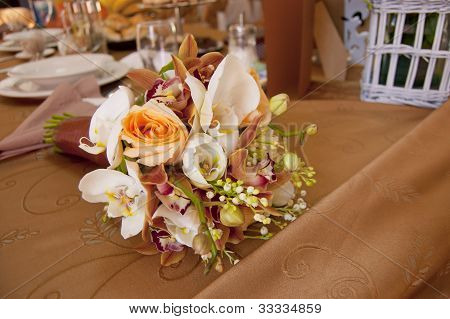 Bride And Groom Table With Bride's Bouquet At Wedding Reception