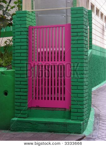 Pink Door On A Green Fence