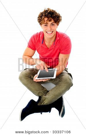 Smiling Young Guy Using His Tablet Pc