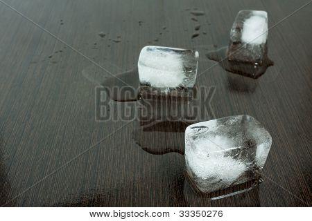ice cubes on wet wenge