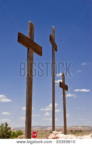 Three Crosses And A Stop Sign