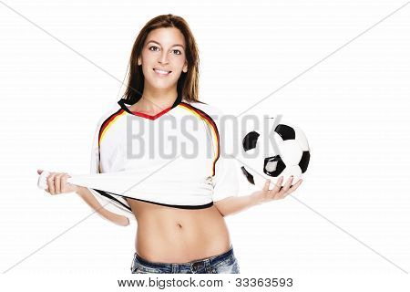 confident young woman holding football pulling her shirt