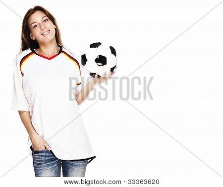 smiling woman wearing football shirt presenting a football