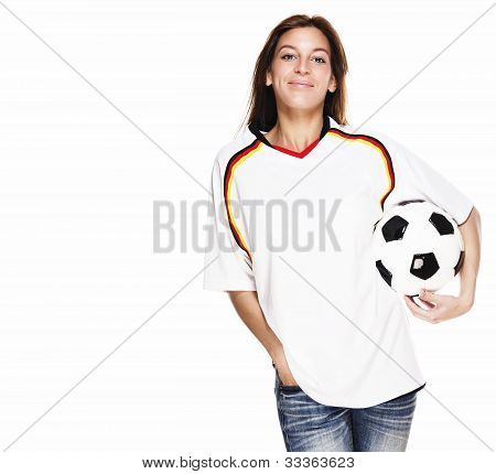 smiling woman wearing football shirt with football under her arm