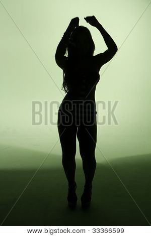 Silhouette of a female dancing