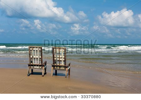 Two Wooden Canvas Chairs On Tropical Beach