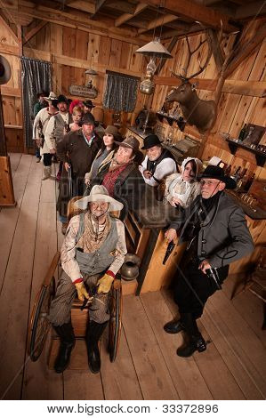 Relaxed Crowd With Guns In Saloon