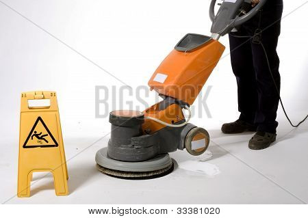 cleaning floor with machine