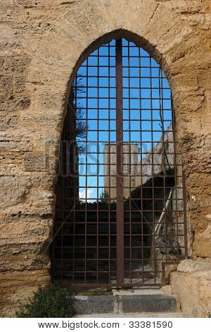 Barred gate of medieval castle