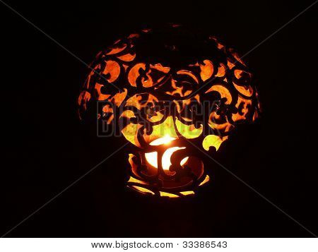Carved coconut candle holder