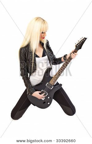 Sexy Blonde Girl Rockstar In Black Leather Jacket Playing Black Electric Guitar