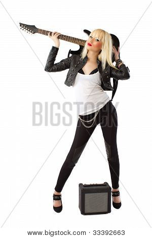 Sexy Blonde Woman In Black Leather Jacket Posing With Black Electric Guitar