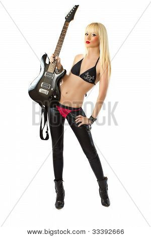 Sexy Blonde Woman In Posing With Black Electric Guitar