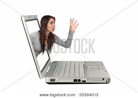 Attractive Brunette Reaching From A Laptop (1)