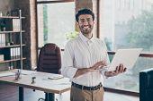 Portrait Of Positive Confident Smart Middle Eastern Entrepreneur Man Hold Laptop Using Feel Success  poster