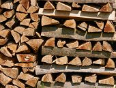 Chopped Firewood On A Stack. Firewood Stacked And Prepared For Winter poster