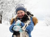 An Incredibly Happy Child With A Little Goat In Her Arms. Much Snow. Unexpected Frosts, Change Of We poster