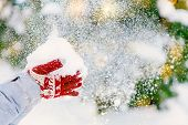 Flying Snowflakes From Hands In Red Mittens. Blowing Snow In Frosty Winter Day. Christmas Time. poster
