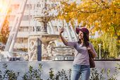 A Happy Young Woman Take Selfie Photo Near The Budapest Eye Big Ferris Wheel In Budapest poster