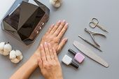 Stylish Trendy Manicure Accessories With Gel Nail Polishes, Scissors, Cuticle Pusher, Led Lamp And F poster