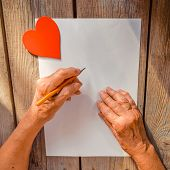 Elderly Woman Hand Going To Write A Letter, Red Heart On Rustic Wooden Table As A Background, Sun Ra poster