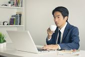 Asian Financial Advisor Or Asian Consulting Businessman Drinking Coffee In Break Time. Asian Busines poster