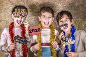 Three Cute Kids Celebrating New Years Eve. 2020! poster