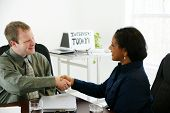 pic of interview  - Interview in an office man and woman shaking hands - JPG