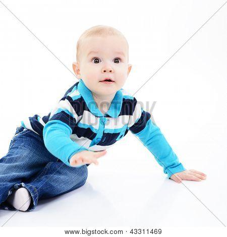 full legth portrait of cute happy smiling little boy toddler sitting in studio, 11 month, studio over white