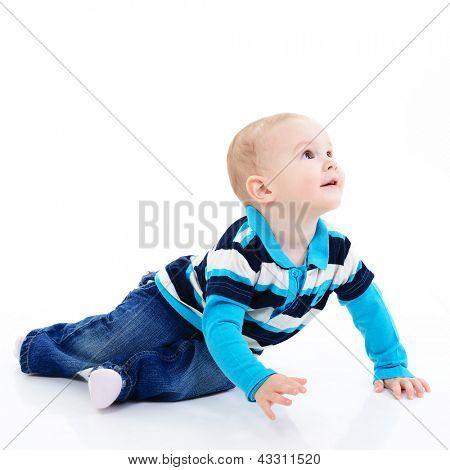 full length portrait of cute happy smiling little boy toddler sitting in studio, 11 month, studio over white