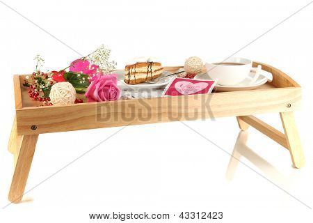 Breakfast in bed on Valentine's Day isolated on white