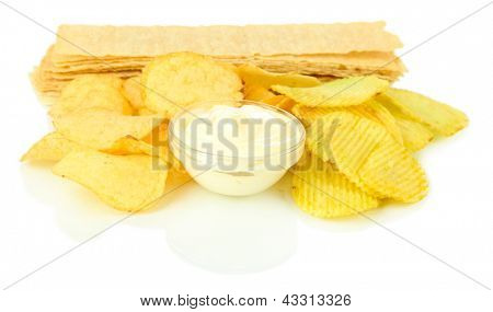 Potato chips and sauce, isolated on white