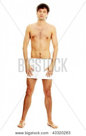 Young handsome nude man covering his self with a copy space blank billboard isolated on white