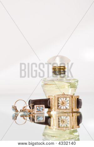 Golden Jewellery And Perfume