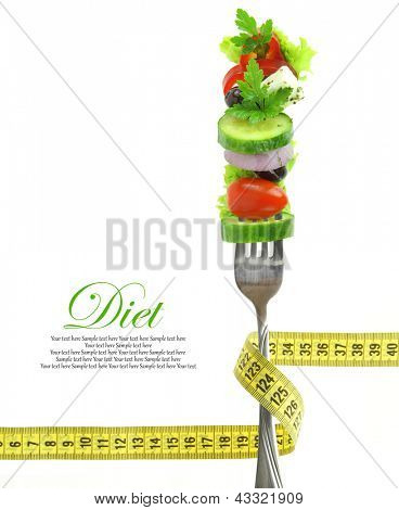 Fresh mixed vegetables on fork with measuring tape