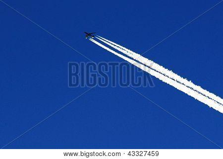 Aeroplane against the blue sky