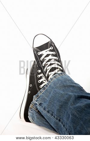 Person In Jeans And Sneakers