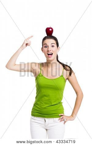 Healthy woman pointing to a apple over her head, isolated in white background